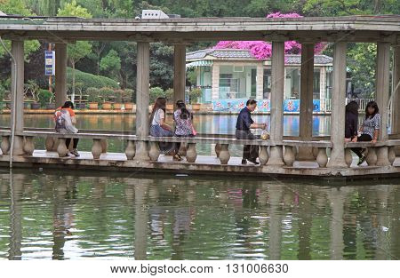 People Are Resting In Water Pavillion On The Lake, Kunming, China