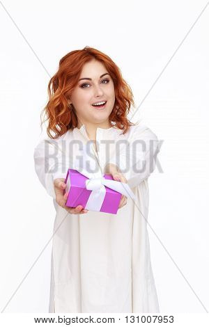 Young woman portrait presenting a gift or present