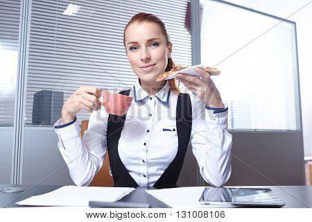 businesswomen with pizza