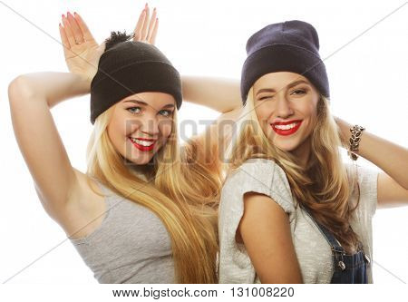 two young girl friends wearing hats