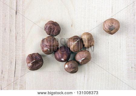 heap hazelnuts closeup on wooden background closeup