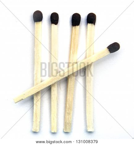 Five ordinary matches on a white background isolated closeup