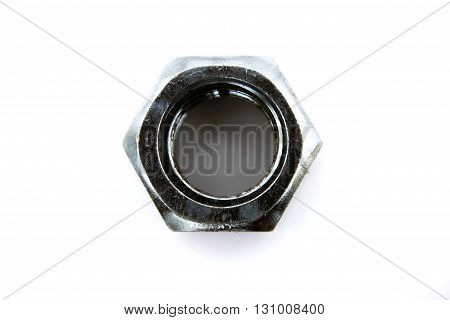 shining big steel metal hex nut with female thread on white background isolated closeup