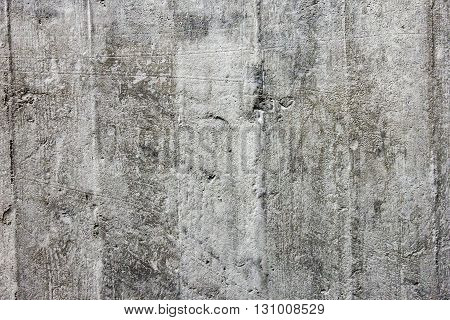 Rough surface grey monolithic concrete as a texture close-up