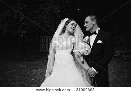 B&w Photo Of Young Fashion Wedding Couple On Dark Forest