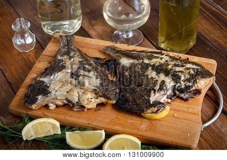 grilled flounder fish on the wooden table