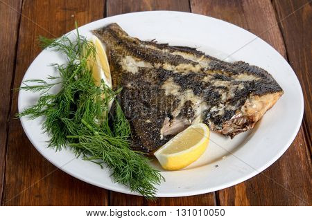 grilled flounder fish on the white plate