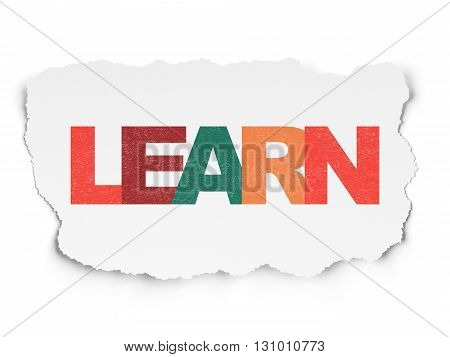 Learning concept: Painted multicolor text Learn on Torn Paper background