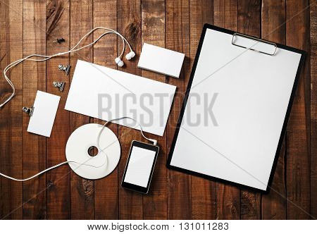 Blank stationery set on vintage wooden table background. Blank corporate identity template. Blank branding mock-up. ID template. Mockup for branding identity. Top view.