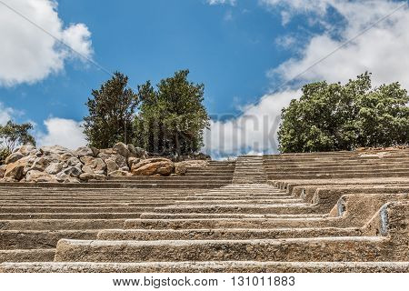 Stairs leading upwards with rows of seating at Mt. Helix Park in La Mesa, a city in San Diego, California.