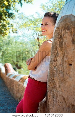 Happy Young Woman Spending Time In Park Guell, Spain