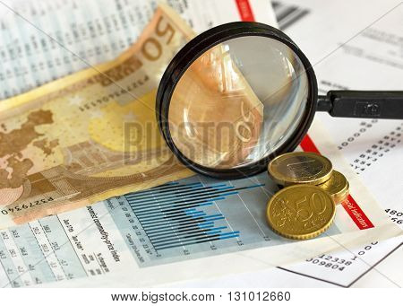 Price index graph magnifying glass and euro currency