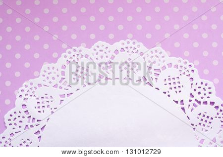 A cute polka dot background with a beautiful napkin and a place for your text.