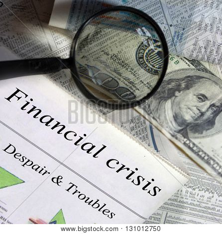 Financial crisis headlines. Magnifying glass and one hundred dollar bill in the background.