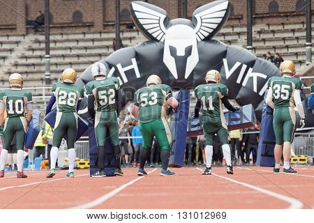STOCKHOLM SWEDEN - MAY 14 2016: Football player lineup they are the first obstarcle in the obstacle race Tough Viking Event in Sweden April 14 2016