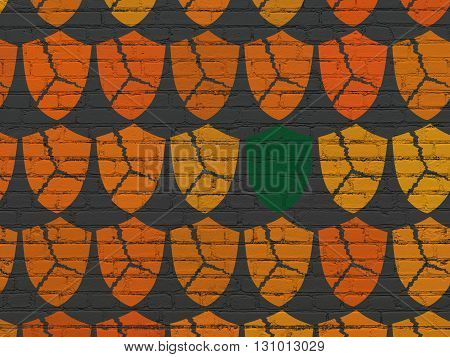 Privacy concept: rows of Painted orange broken shield icons around green shield icon on Black Brick wall background