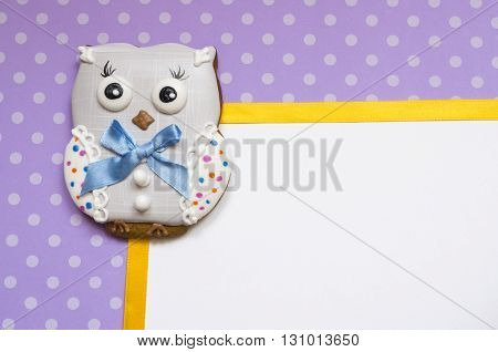 A cute polka dot background with a handmade honey-cake owl and a place for your text for a baby shower party, a birthday party or other events.