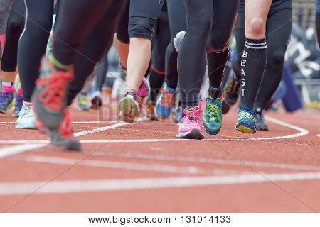 STOCKHOLM SWEDEN - MAY 14 2016: Colorful running feet and legs after the start in the obstacle race Tough Viking Event in Sweden April 14 2016