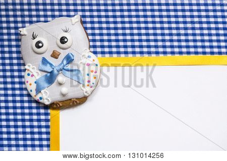 A cute vichy background with a handmade honey-cake owl  and a place for your text for a baby shower party, a birthday party or other events.