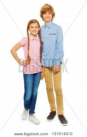 Two happy teenagers, boy and girl, standing and looking to the camera, isolated on white background