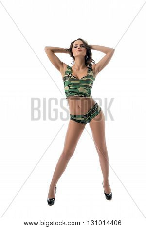 Studio photo of leggy brunette posing in khaki underwear