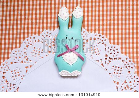 A cute vichy background with a handmade honey-cake rabbit and a place for your text for a baby shower party, a birthday party, an Easter party or other events.