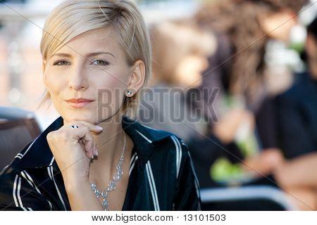 Closeup portrait of attractive businesswoman, thinking.