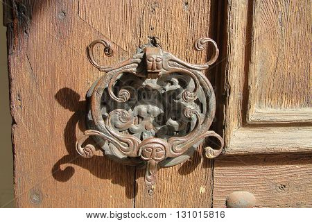The picture was taken in Germany in the old town of Straubing. The picture shows an ancient door handle which is preserved from the time of the Middle Ages.