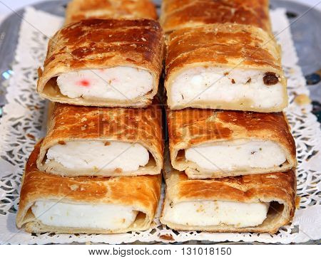 Strudel with curd cheese and raisins on plate at rural retail market