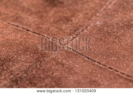 Brown leather background with stitch, close up