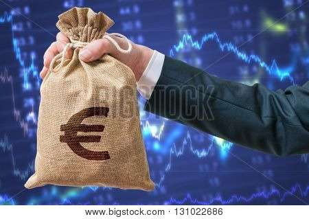 Economics Of Eurozone. Businessman Holds Bag With Money With Eur