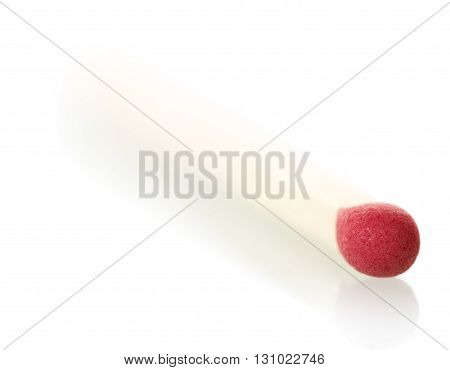 Red match close-up isolated on white background.
