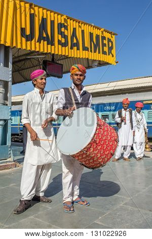 Jaisalmer, India - March 13, 2016: Traditional rajasthani musicians posing for photo under the big