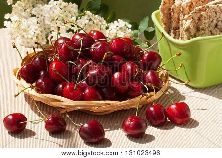 Fresh cherries and cereal biscuits for healthy eating
