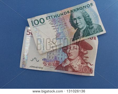 Swedish currency SEK from Sweden over blue background