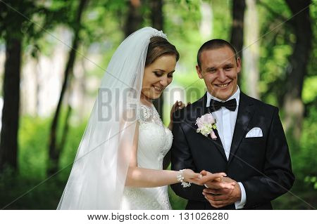 Happy Smiled Groom Hold Hand Of Bride