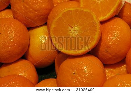 Oranges on display on a market counter useful as background