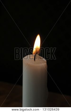 Candle Lit On A Restaurant Table