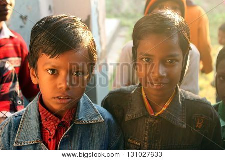 BAIDYAPUR, INDIA - DECEMBER 02: Children after Mass stand in front of the church in Baidyapur, West Bengal, India on December 02, 2012.