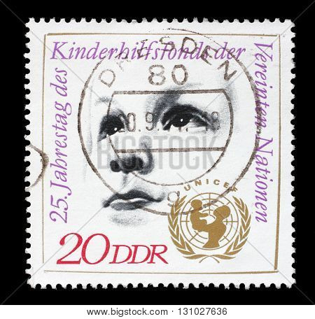 ZAGREB, CROATIA - JULY 03: A stamp printed by GDR shows Childs Head and UNICEF Emblem, devoted 25th anniversary of UNICEF, circa 1971, on July 03, 2014, Zagreb, Croatia