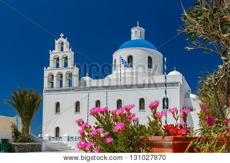 Main white blue orthodox church of Panagia Platsani, in the village of Oia. Santorini.