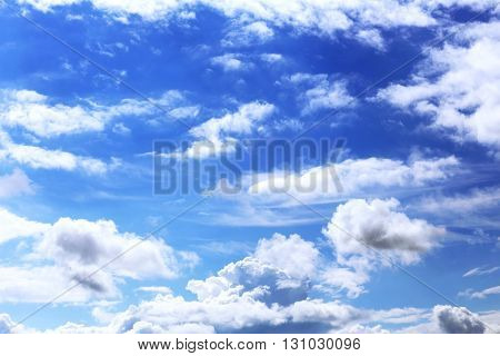 White clouds in a dark blue sky