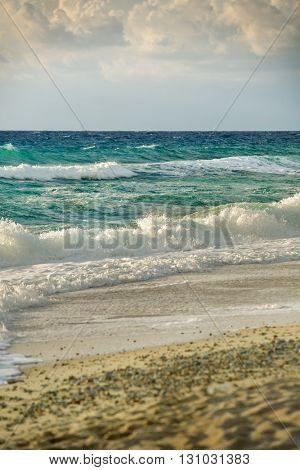 Empty beach with restless seas
