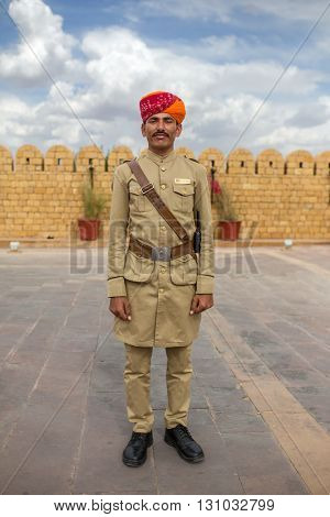 Jaisalmer, India - March 13, 2016: Hotel guard with moustache and traditional rajasthani turban posing for photo.