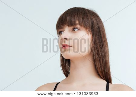 Closeup portrait of a beautiful woman looking away isolated on a white background
