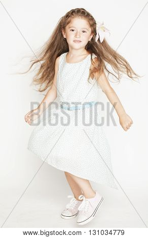 little cute spring girl with lily flower in fancy dress isolated on white background jumping flying, lifestyle people concept