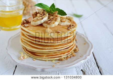 Pancake with banana covered with honey or maple syrup with copy space