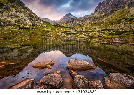 Mountain Lake Above Skok Waterfall with Rocks in Foreground and Strbsky Peak in Background at Sunset. Mlynicka Valley High Tatra Slovakia.