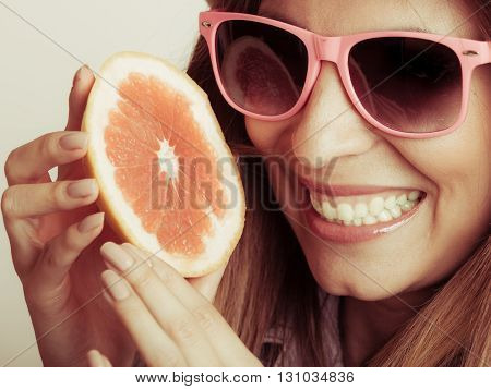 Happy glad woman tourist in straw hat drinking grapefruit juice. Healthy diet food. Weight loss. Summer vacation holidays.
