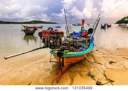Long-tail boats at Rawai beach at low tide Phuket Thailand